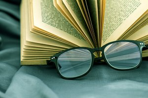 Readind eyeglasses with book
