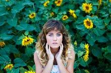 Cute girl in a field of sunflowers