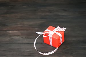 Present box with a red ribbon