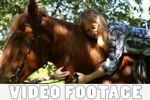 Girl hugging a horse on horseback