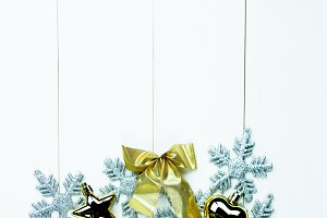 Shiny Christmas holiday ornaments on white wood background - ready to insert text