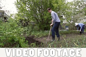 Man digging shovel in the garden