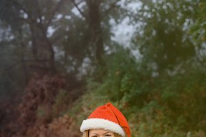 Woman with red Christmas hat
