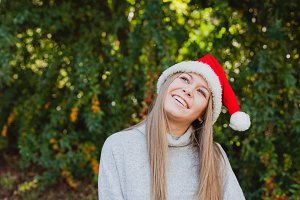 Happy girl with red Christmas hat