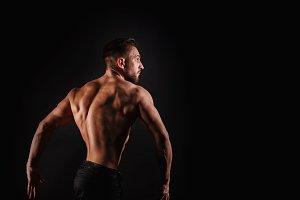 Bodybuilder Posing. Dorsi muscle