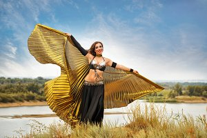 Girl dancing with golden wings