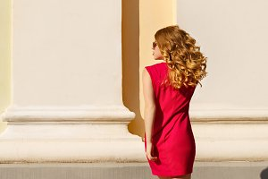 Girl in a red dress with curly hair