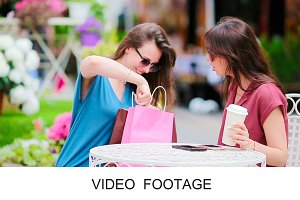 Nice girl friends using smartphone