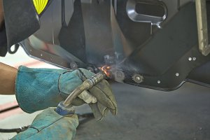 man welding steel