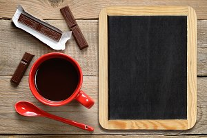 Coffee cup and blackboard