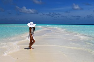 Girl at maldivian sandbank