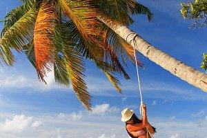 Girl on swing, Maldives (vertical)