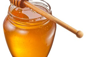 honey and wooden stick