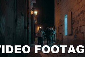 Group of men walking in night Prague