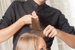 hairstylist wet hair combing woman