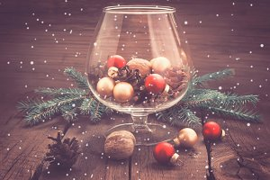 Pine cones, nuts and Christmas toys in the glass