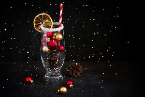 Festive cocktail of Christmas tree decorations and fir cones.