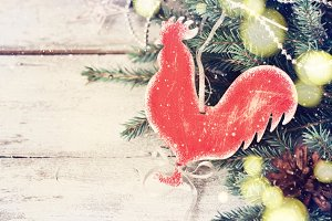 Festive Christmas vintage background with a homemade toy Rooster