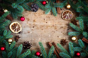 Christmas background. Fir branches Toys Spices arranged in a cir