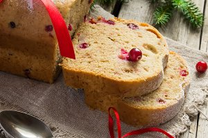 Christmas cake with cranberries and tree branches
