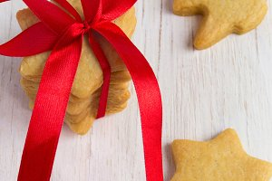 Christmas homemade gingerbreads Stars with a red bow