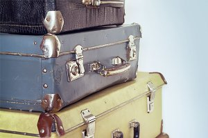 Vintage travel concept with baggage. Pastel colors