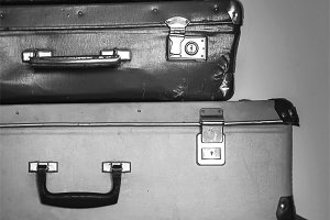 Vintage travel concept with baggage on black and white colors.
