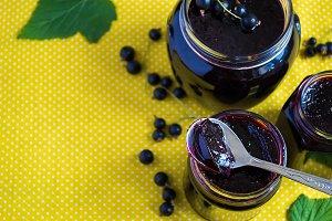 Black currant jam. Selective focus, copy space background