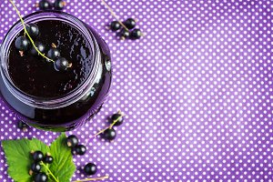 Black currant confiture. Selective focus, copy space background