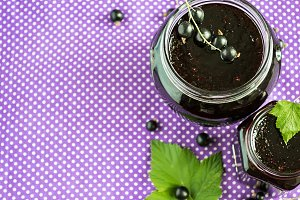 Homemade jam Blackcurrant. Selective focus, copy space background