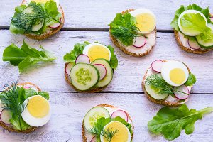 Fresh toast sandwiches with egg, radish, cucumber