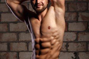 Man athlete poses.