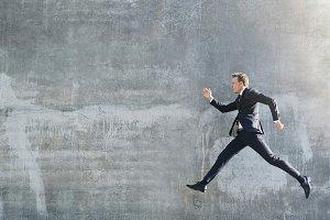 Man in dark suit walking in jump