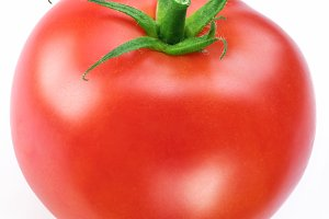 Ripe red tomato. Macro shot studio isolated.