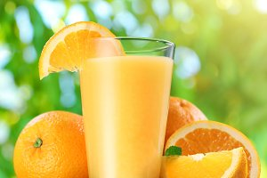 Oranges and glass of orange juice.