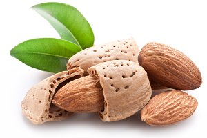 Group of almond nuts. Isolated on a white background.