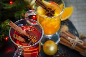 Mulled wine and apple cider in glass cups