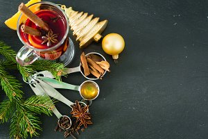 Ingredients for mulled wine on black background