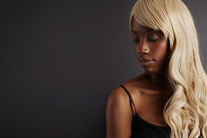 black woman wears blonde wig