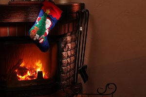 Christmas gifts by the fireplace.