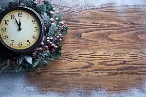 Christmas clock over snow.