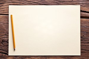 White sheet of paper and pencil