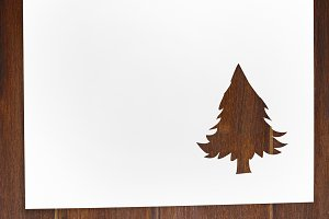 cut paper in fir-tree shape on table