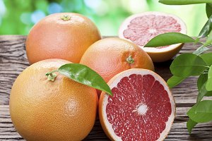 Grapefruits on a wooden table