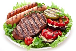 Grilled steak, sausages and veget