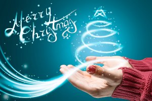 Hands holding christmas tree lights and sparkles