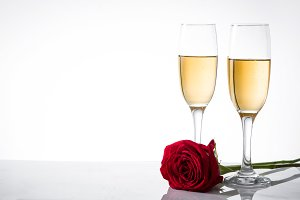Champagne cups and red rose