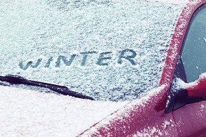 Word winter written a a car