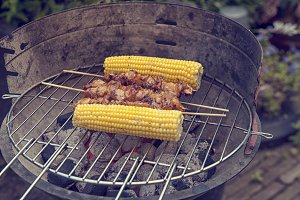 Barbecue with corn and kebab