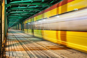 Tram Light Trails on Bridge at Night